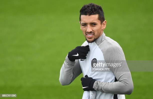 Paris SaintGermain's Brazilian defender Marquinhos arrives for a training session in SaintGermainenLaye western Paris on December 4 on the eve of the...