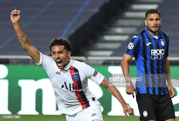 TOPSHOT Paris SaintGermain's Brazilian defender Marquinhos celebrates after scoring a goal during the UEFA Champions League quarterfinal football...