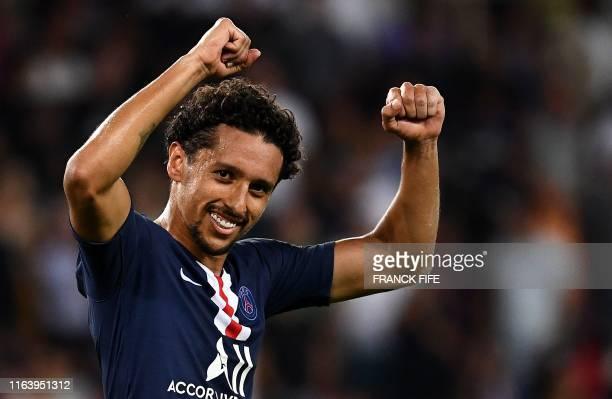 TOPSHOT Paris SaintGermain's Brazilian defender Marquinhos celebrates his goal during the French L1 football match between Paris SaintGermain and...