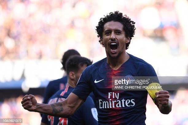 Paris SaintGermain's Brazilian defender Marquinhos celebrates scoring his team's first goal during the French L1 football match between Paris...