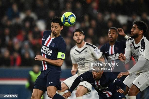 Paris Saint-Germain's Brazilian defender Marquinhos heads the ball and scores a goal during the French L1 football match between Paris Saint-Germain...