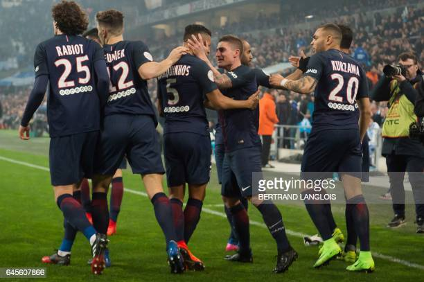 Paris SaintGermain's Brazilian defender Marquinhos is congratulated by his teammate Marco Verratti celebrate after scoring a goal during the French...