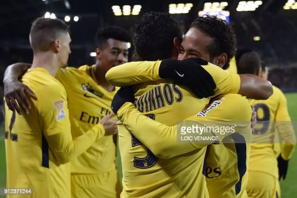 Paris Saint-Germain's Brazilian defender Marquinhos is congratulated by Saint-Germain's Brazilian forward Neymar after scoring a goal during the...