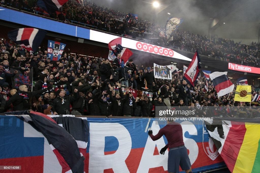 Paris Saint-Germain's Brazilian defender Marquinhos launches his jersey during the French L1 football match between Paris Saint-Germain (PSG) and Marseille (OM) at the Parc des Princes in Paris on February 25, 2018. /
