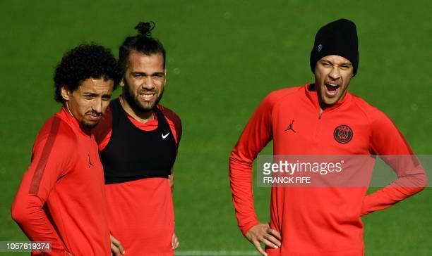 Paris SaintGermain's Brazilian defender Marquinhos Paris SaintGermain's Brazilian defender Dani Alves and Paris SaintGermain's Brazilian forward...