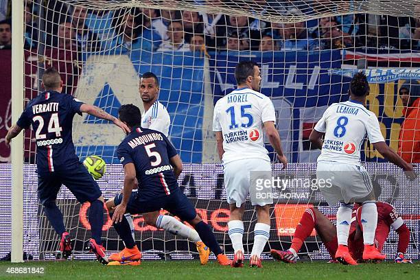 Paris SaintGermain's Brazilian defender Marquinhos scores a goal next to Paris SaintGermain's Italian midfielder and despit of Marseille's Togolese...