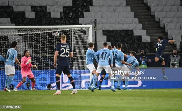 Paris Saint-Germain's Brazilian defender Marquinhos scores a goal during the UEFA Champions League first leg semi-final football match between Paris...