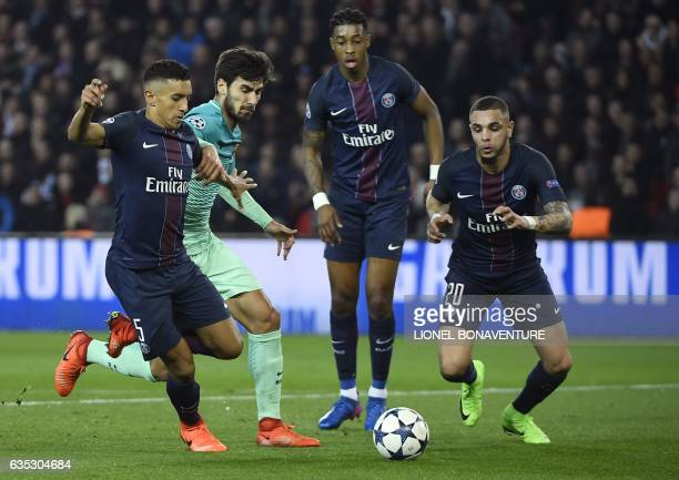 Paris Saint-Germain's Brazilian defender Marquinhos vies with Barcelona's Portuguese midfielder Andre Gomes during the UEFA Champions League round of...