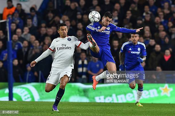 Paris SaintGermain's Brazilian defender Marquinhos vies with Chelsea's Belgian midfielder Eden Hazard during the UEFA Champions League round of 16...