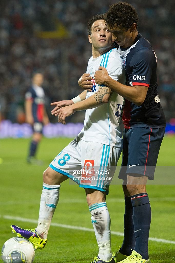 Paris Saint-Germain's Brazilian defender Marquinhos (R) vies with Marseille's French midfielder Mathieu Valbuena during the French L1 football match Olympique de Marseille vs Paris Saint-Germain on October 6, 2013 at the Velodrome stadium in Marseille, southern France.