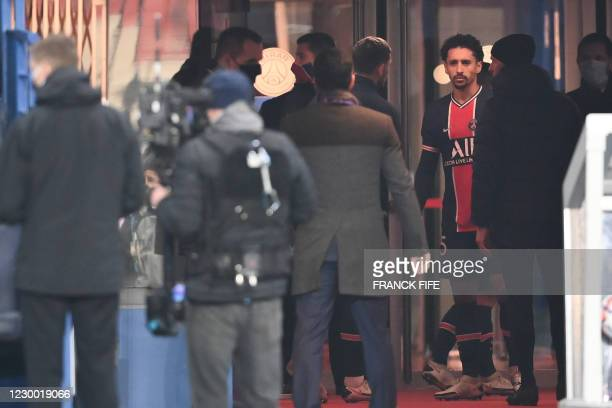 Paris Saint-Germain's Brazilian defender Marquinhos waits after the game was suspended in the first half as the players walked off amid allegations...