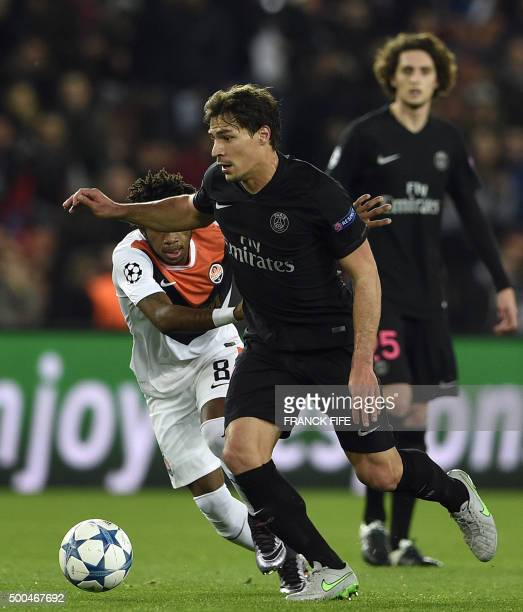 Paris SaintGermain's Brazilian defender Maxwell vies with Shakhtar Donetsk's Brazilian midfielder Fred during the UEFA Champions League Group A...