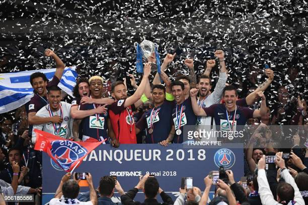 Paris SaintGermain's Brazilian defender Thiago Silva and Les Herbiers' midfielder Sebastien Flochon hold the trophy at the end of the French Cup...