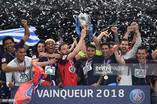 TOPSHOT Paris SaintGermain's Brazilian defender Thiago Silva and Les Herbiers' midfielder Sebastien Flochon hold the trophy at the end of the French...