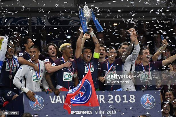 Paris SaintGermain's Brazilian defender Thiago Silva and teammates celebrate with the trophy at the end of the French Cup final football match...