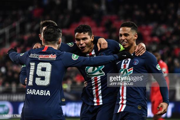 Paris Saint-Germain's Brazilian defender Thiago Silva celebrates after scoring a goal during the French Cup quarter final football match Dijon vs...