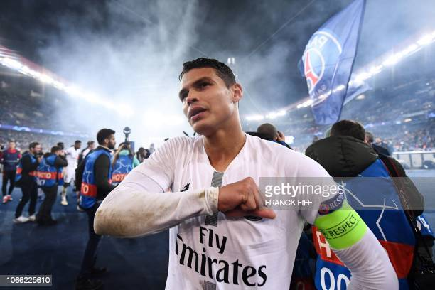 TOPSHOT Paris SaintGermain's Brazilian defender Thiago Silva celebrates at the end of the UEFA Champions League Group C football match between Paris...