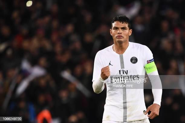 Paris SaintGermain's Brazilian defender Thiago Silva celebrates at the end of the UEFA Champions League Group C football match between Paris...