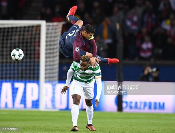 TOPSHOT Paris SaintGermain's Brazilian defender Thiago Silva fights for the ball with Celtic's French striker Moussa Dembele during the UEFA...