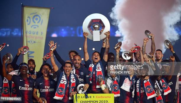 Paris SaintGermain's Brazilian defender Thiago Silva holds the French L1 winner trophy as he celebrates with team mates at the end of the French...