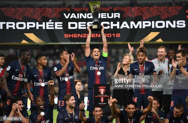 TOPSHOT Paris SaintGermain's Brazilian defender Thiago Silva holds the trophy as he celebrates with team mates after winning the French Trophy of...