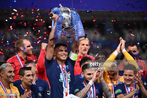 Paris SaintGermain's Brazilian defender Thiago Silva holds the trophy after winning the French Cup final football match between Paris SaintGermain...