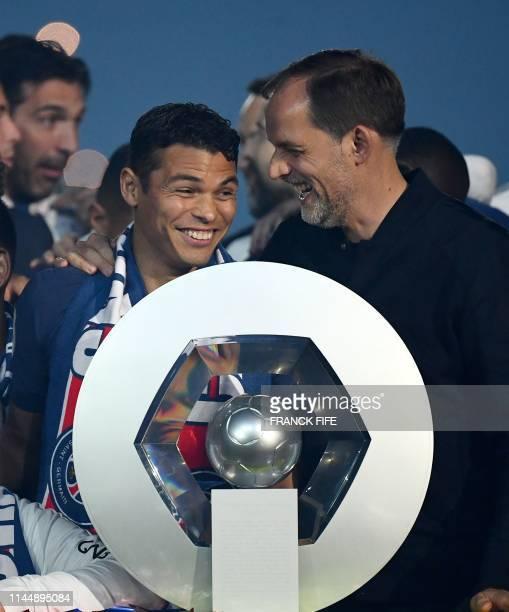 Paris Saint-Germain's Brazilian defender Thiago Silva jokes with Paris Saint-Germain's German head coach Thomas Tuchel in front of the French L1...