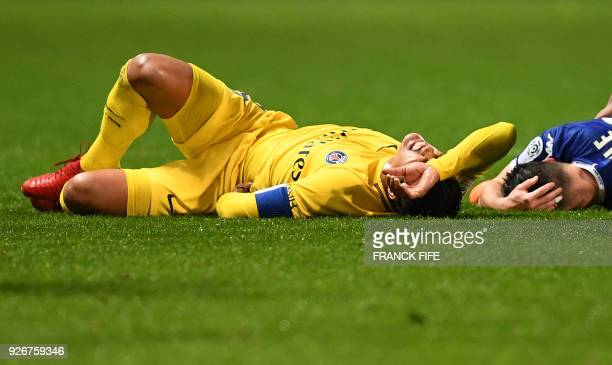 Paris SaintGermain's Brazilian defender Thiago Silva lies on the lawn during the French L1 football match between Troyes and Paris SaintGermain at...