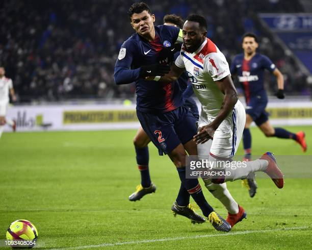 Paris SaintGermain's Brazilian defender Thiago Silva makes a fault on Lyon's French forward Moussa Dembele leading the referee to call for a penalty...