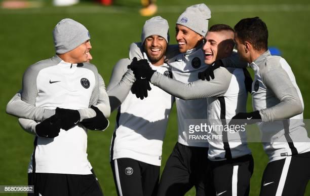Paris SaintGermain's Brazilian defender Thiago Silva Paris SaintGermain's Brazilian midfielder Lucas Moura Paris SaintGermain's Brazilian defender...