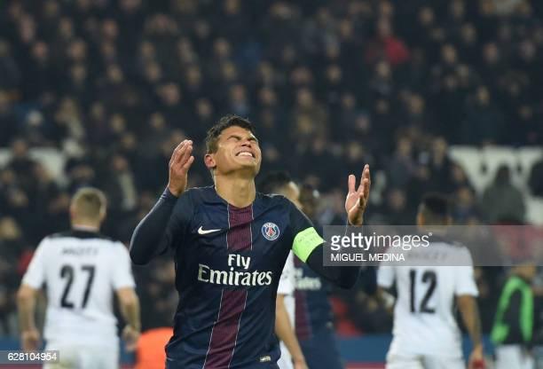 TOPSHOT Paris SaintGermain's Brazilian defender Thiago Silva reacts after a missed goal attempt during the UEFA Champions League Group A football...