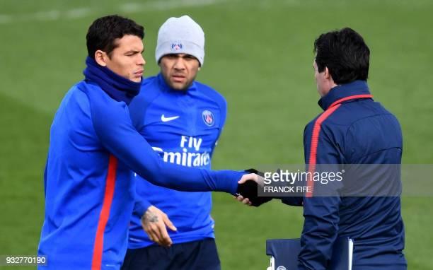 Paris SaintGermain's Brazilian defender Thiago Silva shakes hands with Paris SaintGermain's Spanish headcoach Unai Emery as Paris SaintGermain's...