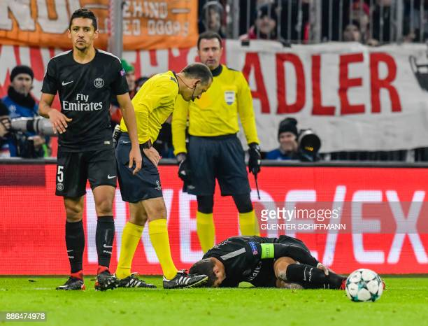 Paris SaintGermain's Brazilian defender Thiago Silva sits injured on the pitch during the UEFA Champions League football match between Paris...