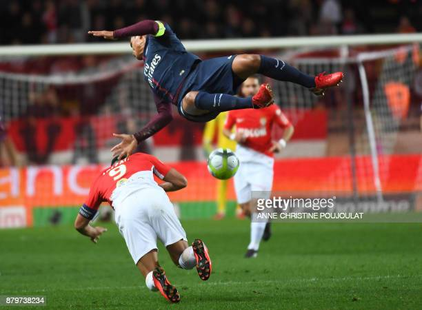 TOPSHOT Paris SaintGermain's Brazilian defender Thiago Silva vies for the ball with Monaco's Colombian forward Radamel Falcao during the French L1...