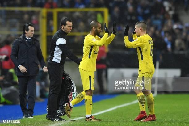 Paris SaintGermain's Brazilian forward Lucas leaves the pitch to replace Paris SaintGermain's Italian midfielder Marco Verratti next to their Paris...