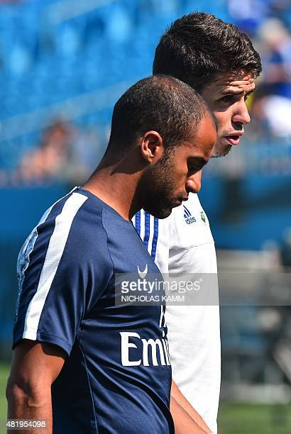 Paris SaintGermain's Brazilian forward Lucas Moura and Chelsea's Brazilian midfielder Oscar chat before an International Champions Cup football match...