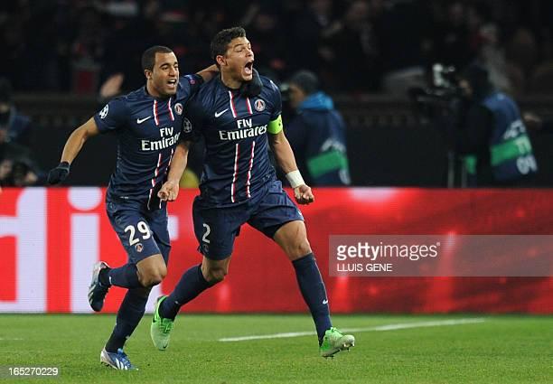 Paris Saint-Germain's Brazilian forward Lucas Moura and Paris Saint-Germain's Brazilian defender and captain Thiago Silva celebrate after Paris...