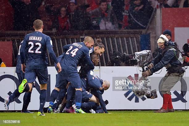 Paris SaintGermain's Brazilian forward Lucas Moura celebrates with teammates after scoring during the French L1 football match Paris SaintGermain vs...