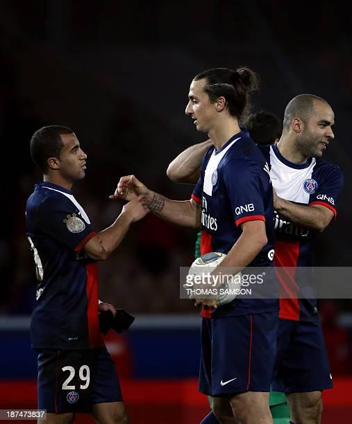 Paris SaintGermain's Brazilian forward Lucas Moura Swedish forward Zlatan Ibrahimovic and Brazilian defender Alex Costa celebrate at the end of the...