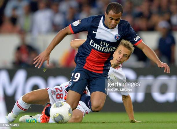 Paris SaintGermain's Brazilian forward Lucas Moura vies with Ajaccio's midfielder Benoit Pedretti during the French L1 football match between Paris...