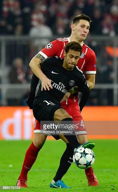 Paris SaintGermain's Brazilian forward Neymar and Bayern Munich's German defender Niklas Suele vie for the ball during the UEFA Champions League...