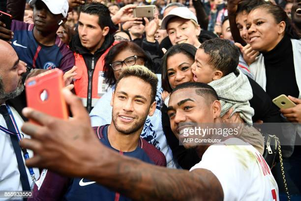 Paris SaintGermain's Brazilian forward Neymar and Bordeaux's Brazilian forward Malcom take a selfie at the end of the French L1 football match...