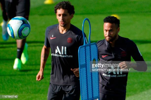 Paris SaintGermain's Brazilian forward Neymar and defender Marquinhos attend a training session on September 13 2019 at the club's Camp des Loges...