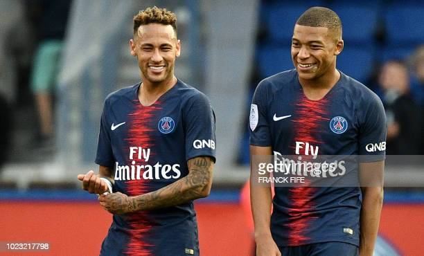 Paris SaintGermain's Brazilian forward Neymar and Paris SaintGermain's French forward Kylian Mbappe react at the end of the French L1 football match...
