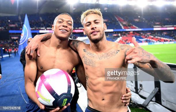 TOPSHOT Paris SaintGermain's Brazilian forward Neymar and Paris SaintGermain's French forward Kylian Mbappe celebrate after winning the French L1...