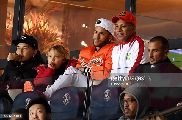 Paris SaintGermain's Brazilian forward Neymar and Paris SaintGermain's French forward Kylian Mbappe react during the French Ligue 1 football match...