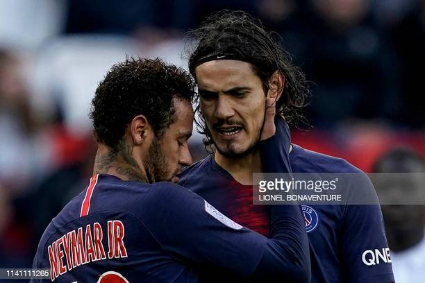 Paris SaintGermain's Brazilian forward Neymar and Paris SaintGermain's Uruguayan forward Edinson Cavani react during the French L1 football match...