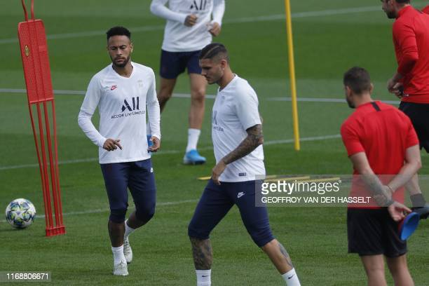Paris SaintGermain's Brazilian forward Neymar and Paris SaintGermain's Argentine forward Mauro Icardi warm up during a training session at the club's...