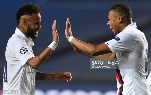 TOPSHOT Paris SaintGermain's Brazilian forward Neymar and Paris SaintGermain's French forward Kylian Mbappe celebrate after winning at the end of the...