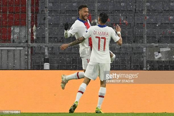 Paris Saint-Germain's Brazilian forward Neymar and Paris Saint-Germain's Argentinian midfielder Angel Di Maria celebrate the 0-1 goal during the UEFA...